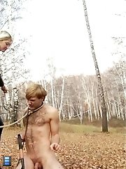 Lady Ropes Her Slave To The Tree And Kicks His Body